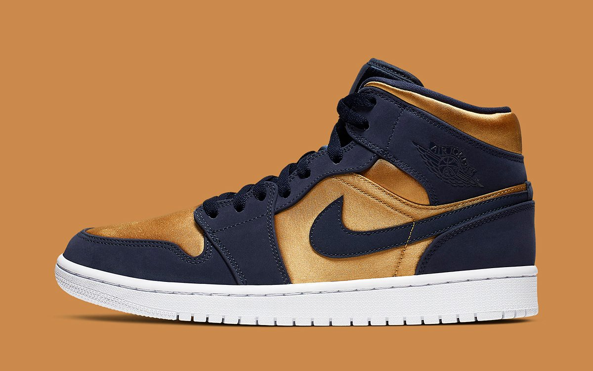 The Air Jordan 1 Mid Surfaces in Silky Gold Satin