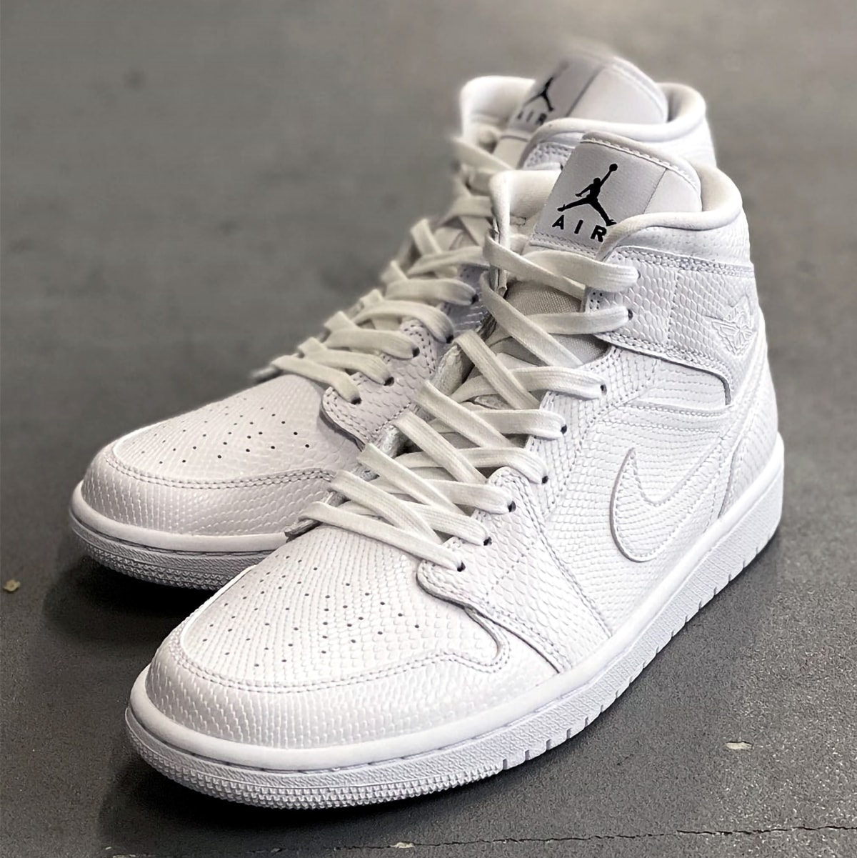 Available Now Air Jordan 1 Mid White Snakeskin House Of Heat Sneaker News Release Dates And Features